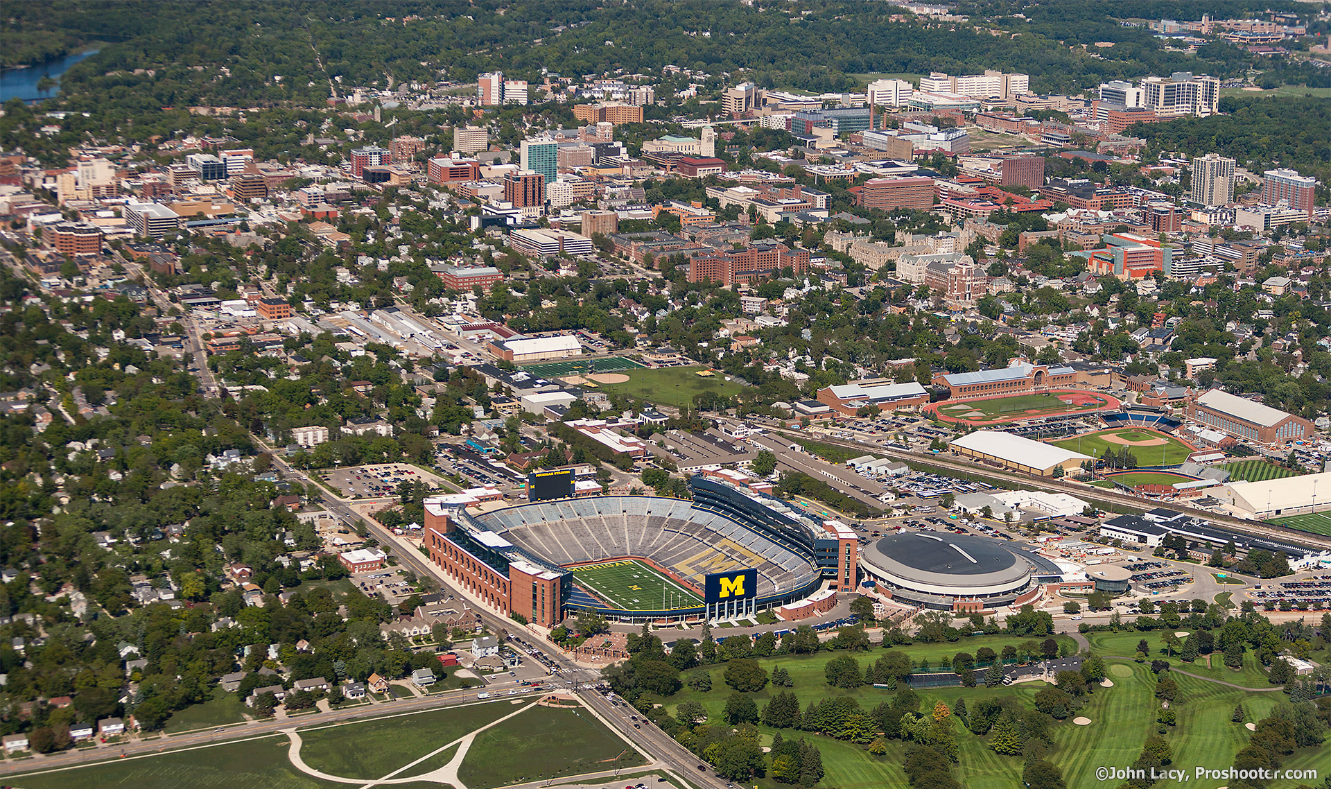 Michigan Stadium aerial photo with Ann Arbor and Campus in background by Proshooter